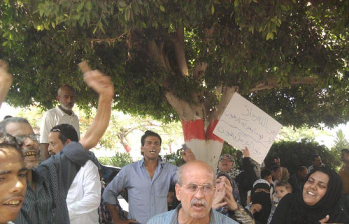 بالصور.. تجدد تظاهرات سكان شقق الخانكة احتجاجاً على قرار طردهم