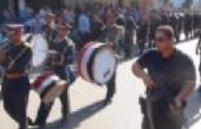 بالصور| جنازة عسكرية لشهيد الشرطة ضحية مؤيدي مرسي في المنيا