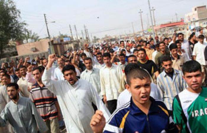 عراقيون يحيون ذكرى وفاة الإمام على بالتطبير