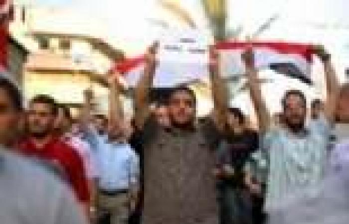 وقفة حداد على شهداء الشرطة والجيش في عزبة البرج بدمياط