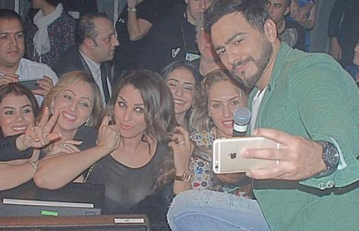 """تامر حسنى ينشر صورًا لحفلته الغنائية فى بلجيكا عبر """"فيس بوك"""""""