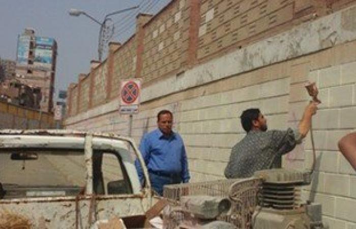 إزالة عبارات مسيئة كتبها الإخوان على جدران نفق أبو الريش فى الزقازيق