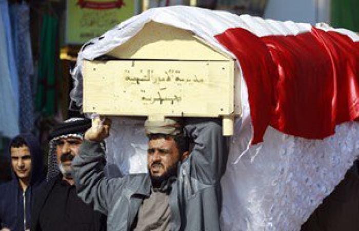 بالصور.. فستان عرس على تابوت جندى عراقى قتل بعد أيام من زفافه