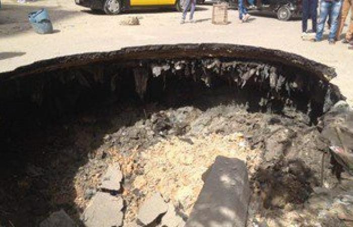 """""""الصرف الصحى"""": طفح المياه أسفل كوبرى المندرة نتيجة الهبوط الأرضى بالإسكندرية"""