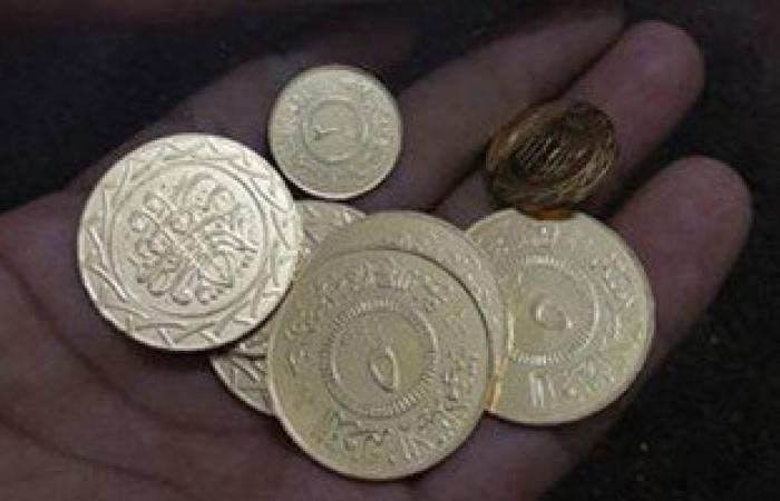 """بالصور.. """"داعش"""" يعمم عملات معدنية خاصة به فى الرقة السورية"""