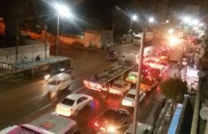 بالصور.. استمرار هطول الأمطار وشلل مرورى غرب الإسكندرية