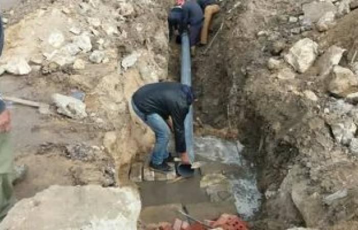 بالصور.. ربط 10 شنايش بشبكة المعمورة الرئيسية لمنع تراكم المياه شرق الإسكندرية