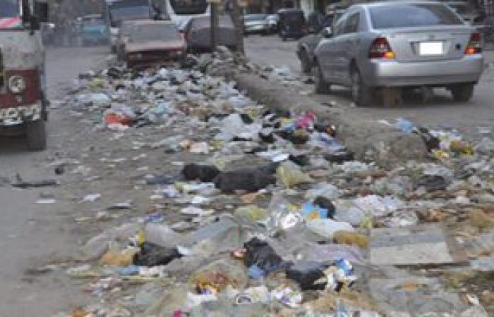 بالصور...شبرا الخيمة تستقبل العام الجديد بتراكم القمامة بالشوارع الرئيسية