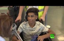 صبي عراقي بساق واحدة يعود إلى موسكو لإتمام العلاج