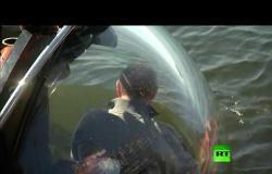 شاهد بوتين تحت الماء يتفقد غواصة تاريخية غارقة