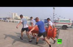 فريق غواصي البحرية الروسية ينجز تدريباته بجزيرة إيرانية في الخليج
