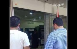 زحام أمام أحد فروع البنك الأهلي بالمهندسين