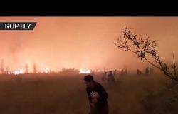 النجاة من نار جهنم.. لقطات من بلدة سيبيرية طوقتها الحرائق