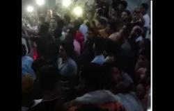"""لحظة دفن جثمان الطالب """"بامبو"""" بعد مقتله على يد زملائه في عين شمس"""