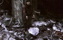 مقاتلون بلجيكيون يشاركون فى قطع رأس رجل فى سوريا